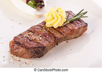 Grilled beef steak topped with butter and rosemary - Tasty ...