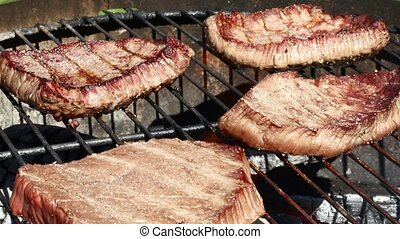 Grilled beef steaks cooking on barbecue grill - Grilled beef...