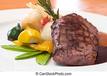 Grilled Beef Steaks - Juicy platter of beef steak served...