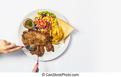 Grilled beef steaks with spices on a plate. Top view