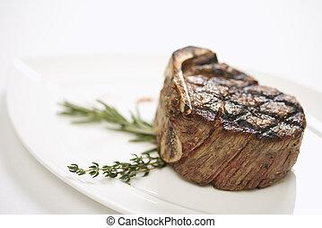 Grilled beef tenderloin on plate.
