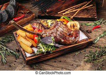 Grilled beef tomahawk steak with vegetables