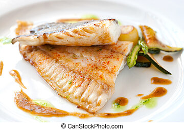 Grilled brill fish. - Close up of grilled brill fish with ...