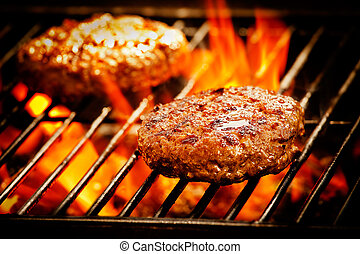 Grilled Burgers - Close up of two grilled beef burgers
