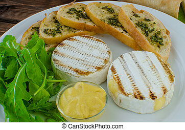 Grilled camembert with baguette and mustard with arugula...
