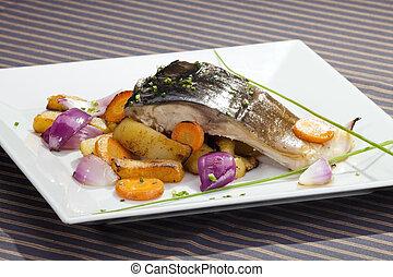 Grilled carp with vegetable garnish