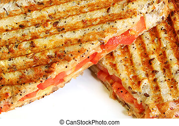 Grilled cheese and tomato sandwich on wholewheat bread. Closeup view.