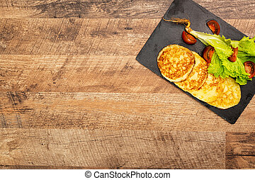 Grilled cheese with vegetables on the plate.