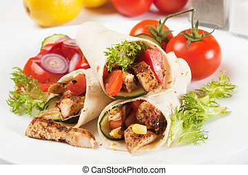 Grilled chicken and salad in tortilla wrap - Grilled chicken...