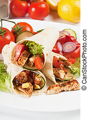 Grilled chicken and salad in tortilla wrap