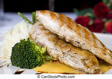 Grilled chicken breast a la carte meal - Closeup detail of a...