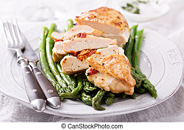 Grilled chicken breast stuffed with mozzarella