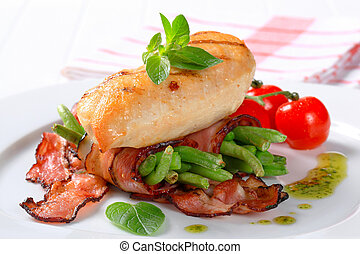 Grilled chicken breast with bacon-wrapped green beans