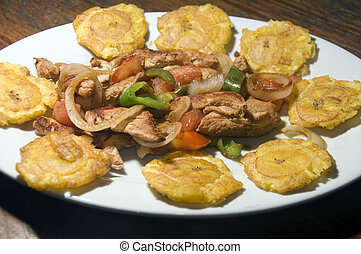 grilled chicken fajita food with local tostones fried...