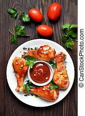 Grilled chicken legs and tomato sauce, top view