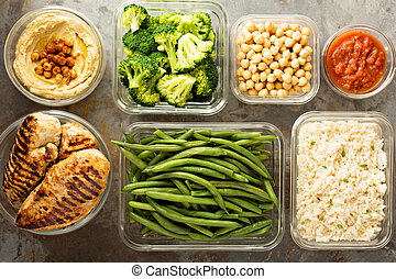 Grilled chicken meal prep with cooked rice and vegetables
