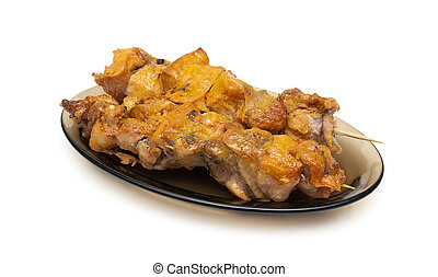Grilled chicken on bamboo skewers on a white background