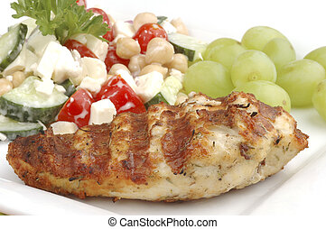 Perfectly grilled chicken and delicious salad with grapes.