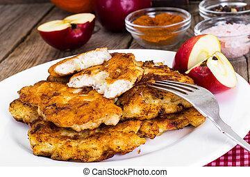 Grilled chicken schnitzel with apple