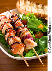 Grilled chicken - Chicken and onion on skewers with salad...