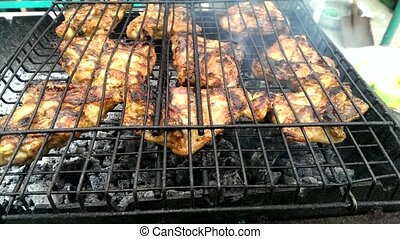 Grilled chicken thighs - Chicken thighs are cooked on...