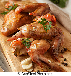 Grilled chicken wings on board. Food concept.