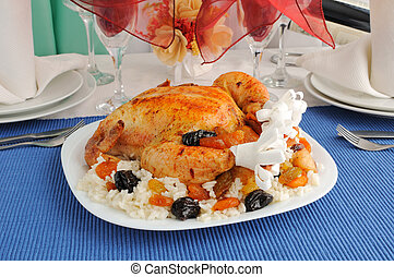 Grilled Chicken with rice and dried fruit on the dining table