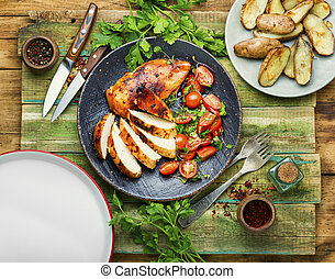 Grilled chicken,chicken breast on rustic wooden table