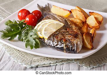 Grilled dorado fish with potatoes closeup. horizontal - ...
