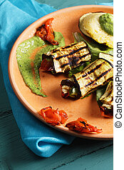 Grilled eggplants with pesto closeup