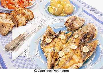 Grilled european seabass with potato and tomato salad -...
