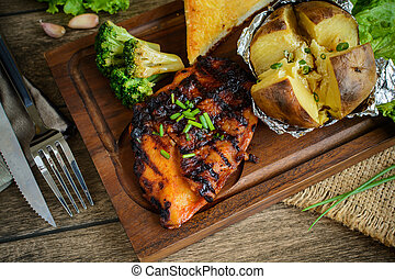 Grilled Fillet of Chicken steak with mash potato on wooden table