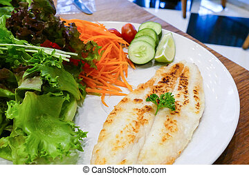grilled fish fillet with vegetable salad