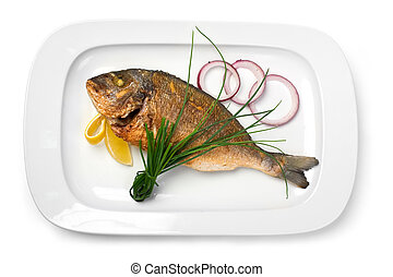 grilled fish on a plate with onions and lemon