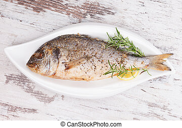 Grilled fish on plate, top view. - Delicious grilled sea ...