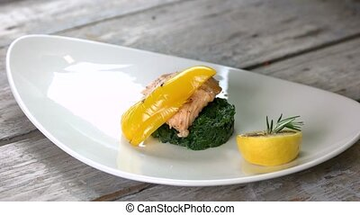 Grilled fish, spinach and sauce. Healthy seafood dish.