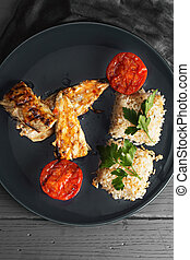 Grilled fish with rice above view