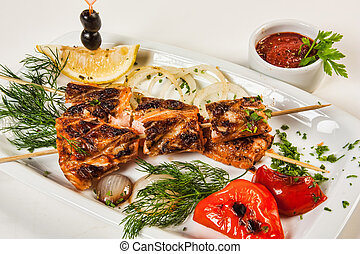 Grilled fish with vegetables and herbs
