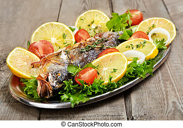 Grilled fish with vegetables and lemon