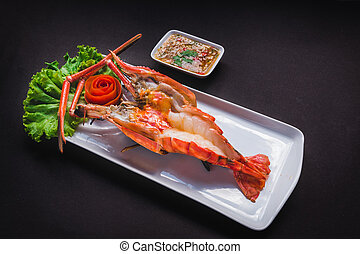 Grilled Giant River Prawn on black background