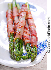 grilled green asparagus wrapped in bacon slices