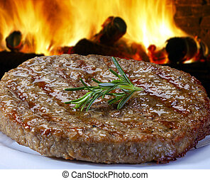 grilled hamburger meat on the grill
