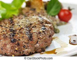 hamburger - grilled hamburger on a plate with salad