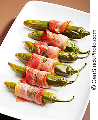 Grilled jalapenos wrapped in bacon