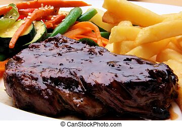 Grilled juicy steak with vegetables and chips