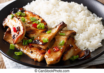 grilled king oyster mushrooms with rice and teriyaki sauce close-up. horizontal