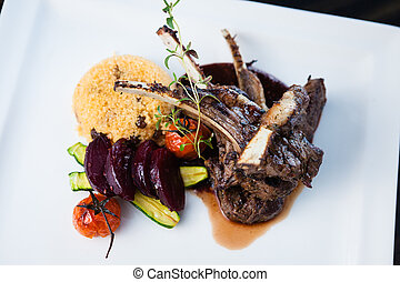 Grilled lamb carre with warm couscous salad, roasted ...