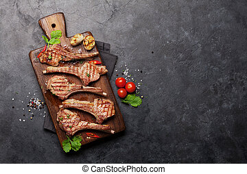 Grilled lamb ribs on cutting board