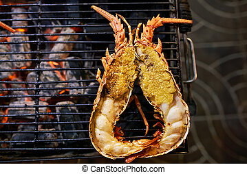 Grilled lobster on street food market in Thailand