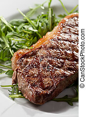 grilled loin steak on rocket salad